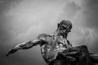 cloudy statue beard cemetery